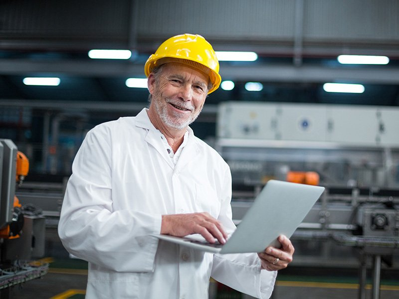 Man in labcoat in factory